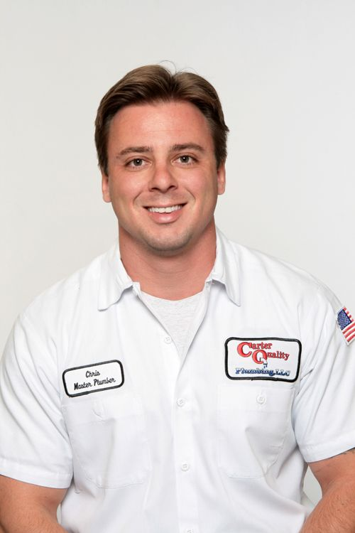 Headshot of Carter Quality Plumbing owner wearing white oxford polo shirt.